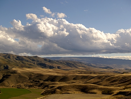 Dramatic clouds above Cluden evening landscape, Central Otago
